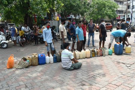 After the cyclone Many of Kolkata's roads are flooded and its 14 million people without power. many areas peoples are getting angry and they blocked the road for they couldn't find any electctiry, water and telephone connection. People are giving line for taking diesel on a pump in Kolkata.