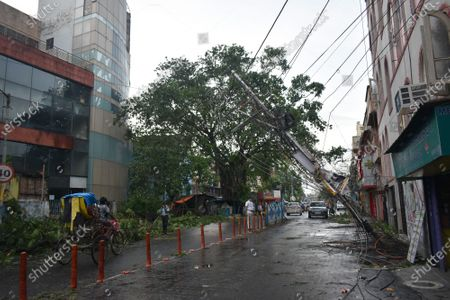 The eastern Indian city of Kolkata has been devastated by a powerful cyclone which has killed at least 84 people across India and Bangladesh. Amphan made landfall on Wednesday, lashing coastal areas with ferocious wind and rain. The storm is weakening as it moves north into Bhutan.Thousands of trees were uprooted in the gales, electricity and telephone lines brought down and houses flattened. Many of Kolkata's roads are flooded and its 14 million people without internet, power and telecommunication. (Photo by Sudipta Das/Pacific Press)