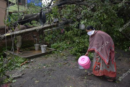 After the cyclone Many of Kolkata's roads are flooded and its 14 million people without power. many areas peoples are getting angry and they blocked the road for they couldn't find any electctiry, water and telephone connection.