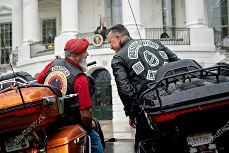 US Actor Robert Patrick, right, talks to an attendee while sitting on motorcycles during a Rolling to Remember ceremony honoring the nation's veterans and prisoners of war/missing in action (POW/MIA) held by US President Donald J. Trump at the White House in Washington, DC, USA, on 22 May 2020.