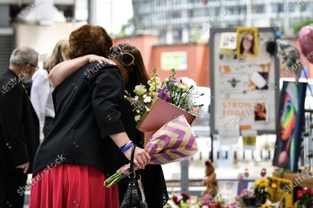 Stock Image of Grieving firnds and family at Manchester's Victoria Station as they remember their loved ones, victims of the Arena terror attack, on this, the 3rd anniversary.