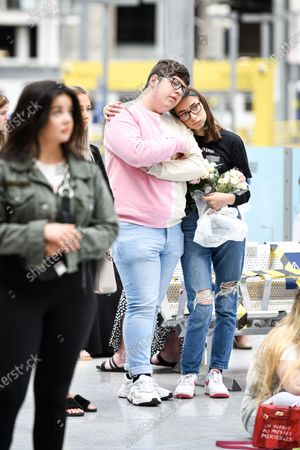 Stock Picture of People come together at Manchester's Victoria Station to pay their respects to the victims of the Arena terror attack, on this, the 3rd anniversary.