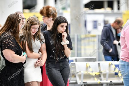 Stock Photo of People come together at Manchester's Victoria Station to pay their respects to the victims of the Arena terror attack, on this, the 3rd anniversary.