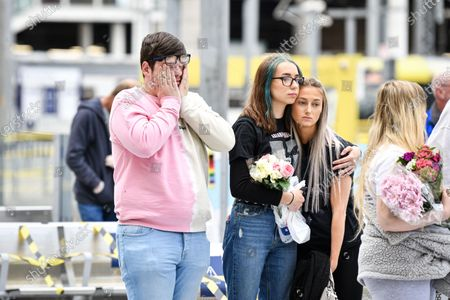 People come together at Manchester's Victoria Station to pay their respects to the victims of the Arena terror attack, on this, the 3rd anniversary.
