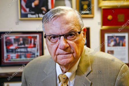 Former Maricopa County Sheriff Joe Arpaio poses for a portrait at his private office in Fountain Hills, Arizona. The taxpayer bill for a racial profiling case focusing on Arpaio's immigration patrols is expected to reach $178 million by the summer of 2021. The money is going toward legal fees and the costs of complying with a court-ordered overhaul of the sheriff's office in response to the 2013 profiling verdict