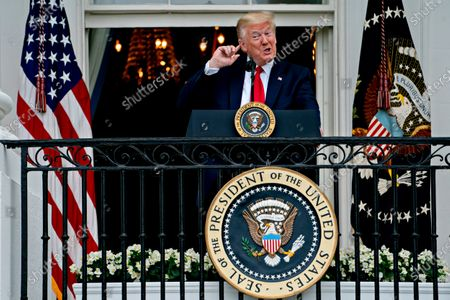 United States President Donald J. Trump arrives to speak from the Blue Room Balcony of the White House during a Rolling to Remember ceremony honoring the nation's veterans and prisoners of war/missing in action (POW/MIA) in Washington, D.C., U.S.,. Trump didn't wear a face mask during most of his tour of Ford Motor Co.'s ventilator facility Thursday, defying the automaker's policies and seeking to portray an image of normalcy even as American coronavirus deaths approach 100,000.