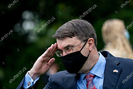 United States Secretary of Veterans Affairs (VA) Robert Wilkie, salutes while wearing a protective mask during a Rolling to Remember ceremony honoring the nation's veterans and prisoners of war/missing in action (POW/MIA) in Washington, D.C., U.S.,. US President Donald J. Trump didn't wear a face mask during most of his tour of Ford Motor Co.'s ventilator facility Thursday, defying the automaker's policies and seeking to portray an image of normalcy even as American coronavirus deaths approach 100,000.