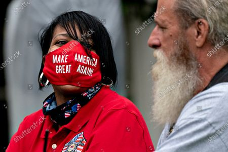 "An attendee wears a ""Make America Great Again"" protective mask during a Rolling to Remember ceremony honoring the nation's veterans and prisoners of war/missing in action (POW/MIA) in Washington, D.C., U.S.,. United States President Donald J. Trump didn't wear a face mask during most of his tour of Ford Motor Co.'s ventilator facility Thursday, defying the automaker's policies and seeking to portray an image of normalcy even as American coronavirus deaths approach 100,000."