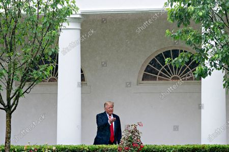 Stock Picture of United States President Donald J. Trump speaks to members of the media while standing in the Colonnade of the White House after a Rolling to Remember ceremony honoring the nation's veterans and prisoners of war/missing in action (POW/MIA) in Washington, D.C., U.S.,. Trump didn't wear a face mask during most of his tour of Ford Motor Co.'s ventilator facility Thursday, defying the automaker's policies and seeking to portray an image of normalcy even as American coronavirus deaths approach 100,000.