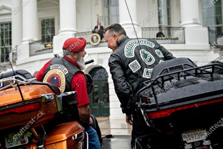 Actor Robbert Patrick, right, talks to an attendee while sitting on motorcycles during a Rolling to Remember ceremony honoring the nation's veterans and prisoners of war/missing in action (POW/MIA) in Washington, D.C., U.S.,. United States President Donald J. Trump didn't wear a face mask during most of his tour of Ford Motor Co.'s ventilator facility Thursday, defying the automaker's policies and seeking to portray an image of normalcy even as American coronavirus deaths approach 100,000.