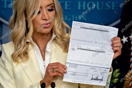 Kayleigh McEnany, White House press secretary, holds a check, in the amount of US President Donald J. Trump's annual salary, to be donated to the U.S. Department of Health and Human Services (HHS) during a news conference in the Brady Press Briefing Room of the White House in Washington, DC, USA, on 22 May 2020.  President Trump ordered states to allow churches to reopen from stay-at-home restrictions imposed to combat the coronavirus outbreak, saying he would override any governor who refuses.