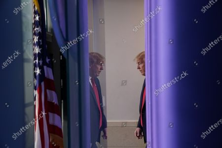 US President Donald J. Trump arrives to a news conference in the Brady Press Briefing Room of the White House in Washington, DC, USA, on 22 May 2020.