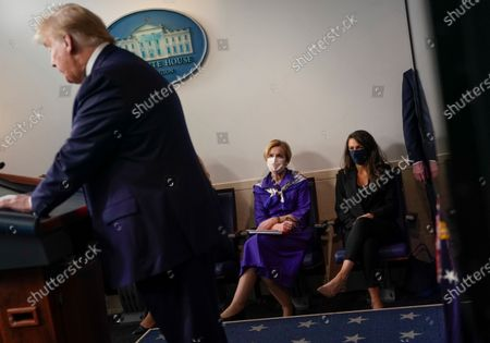 Deborah Birx, White House coronavirus response coordinator, center, listens as US President Donald J. Trump speaks during a news conference in the Brady Press Briefing Room of the White House in Washington, DC, USA, on 22 May 2020.