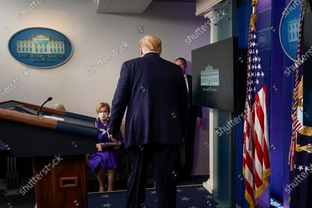 US President Donald J. Trump leaves a news conference in the Brady Press Briefing Room of the White House in Washington, DC, USA, on 22 May 2020.