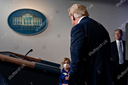 US President Donald J. Trump leaves after speaking during a news conference in the Brady Press Briefing Room of the White House in Washington, DC, USA, on 22 May 2020.