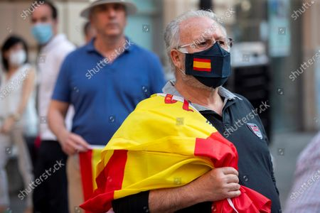 Stock Photo of People attend a protest against the Spanish central government and demand its resignation in Murcia, southern Spain, 22 May 2020. The central government won parliamentary backing on 20 May to extend the nation's state of emergency implemented to stem the widespread of the SARS-CoV-2 coronavirus that causes the COVID-19 disease. It is the fifth two-week extension in a row and will remain in force until 07 June 2020.