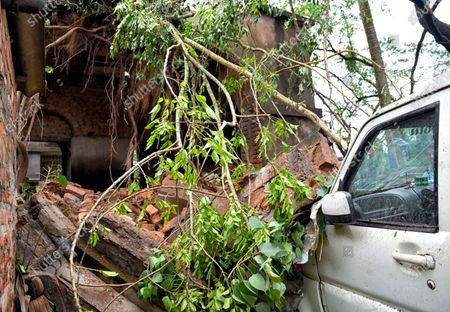 A Scorpio vehicle smashed by a fallen wall from a house during the aftermath. Cyclone Amphan has hit west Bengal with a speed of 150 Km/ hr. which caused huge destruction of lively hood and 76 deaths have been reported so far.
