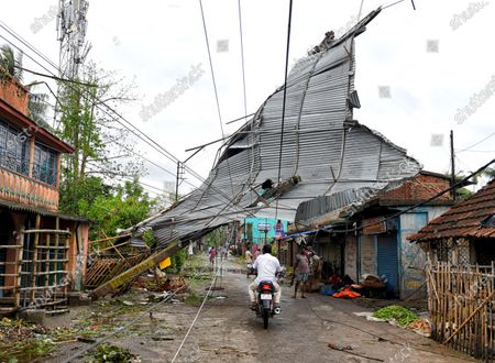 A roof of a house seen hanging on electric wires during the aftermath. Cyclone Amphan has hit west Bengal with a speed of 150 Km/ hr. which caused huge destruction of lively hood and 76 deaths have been reported so far.