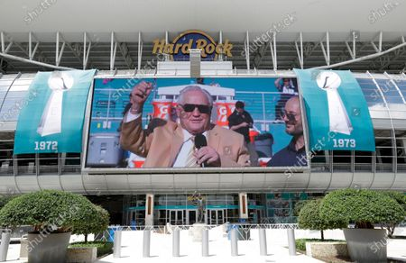 Stock Photo of Video tribute for former Miami Dolphins coach Don Shula plays on a screen at Hard Rock Stadium during a tribute procession for Shula, in Miami Gardens, Fla. Shula died on May 4