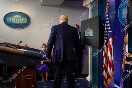 United States President Donald J. Trump leaves a news conference in the Brady Press Briefing Room of the White House in Washington, D.C., U.S.,. Trump didn't wear a face mask during most of his tour of Ford Motor Co.'s ventilator facility Thursday, defying the automaker's policies and seeking to portray an image of normalcy even as American coronavirus deaths approach 100,000.