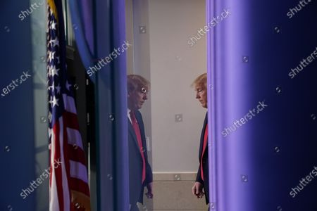 United States President Donald J. Trump arrives to a news conference in the Brady Press Briefing Room of the White House in Washington, D.C., U.S.,. Trump didn't wear a face mask during most of his tour of Ford Motor Co.'s ventilator facility Thursday, defying the automaker's policies and seeking to portray an image of normalcy even as American coronavirus deaths approach 100,000.