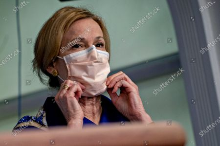 Ambassador Deborah L. Birx, M.D., White House Coronavirus Response Coordinator, adjusts her protective mask during a news conference in the Brady Press Briefing Room of the White House in Washington, D.C., U.S.,. United States President Donald J. Trump did not wear a face mask during most of his tour of Ford Motor Co.'s ventilator facility Thursday, defying the automaker's policies and seeking to portray an image of normalcy even as American coronavirus deaths approach 100,000.