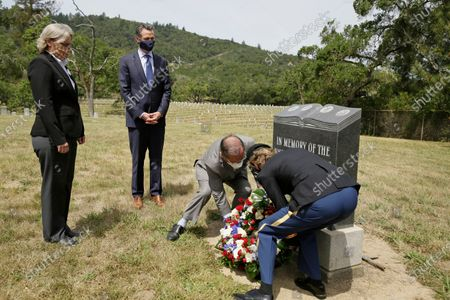 California Governor Gavin Newsom (2-L), watches as CalVet Secretary Vito Imbasciani (2-R), and administrator Lisa Peake (R), lay a wreath in a cemetery as deputy home administrator Stephanie Weaver (L) looks on at the Veterans Home of California  in Yountville, California, USA, 22 May 2020.