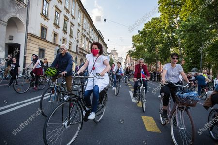 Protesters ride bicycles on the streets of Ljubljana during an anti-government protest. Thousands of people on bicycles and on foot again protested against the government, they accused Prime Minister Janez Jansa of using the covid-19 crisis situation for corruption and undemocratic rule.