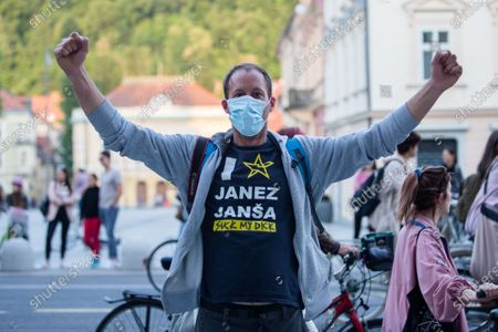 A protester wearing a face mask as preventive measure gestures during an anti-government protest. Thousands of people on bicycles and on foot again protested against the government, they accused Prime Minister Janez Jansa of using the covid-19 crisis situation for corruption and undemocratic rule.