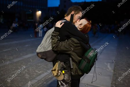 A couple seen kissing on the street as they take part during an anti-government protest. Thousands of people on bicycles and on foot again protested against the government, they accused Prime Minister Janez Jansa of using the covid-19 crisis situation for corruption and undemocratic rule.