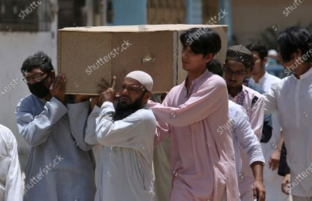 People carry the casket of a victim of Friday's plane crash, for funeral prayers in Karachi, Pakistan, . An aviation official says a passenger plane belonging to state-run Pakistan International Airlines carrying passengers and crew has crashed near the southern port city of Karachi