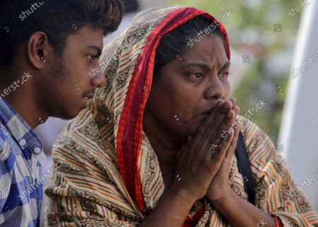 Woman reacts after identifying a body of her family member, who was killed in the Friday's plane crash, at a morgue in Karachi, Pakistan, . An aviation official says a passenger plane belonging to state-run Pakistan International Airlines carrying passengers and crew has crashed near the southern port city of Karachi