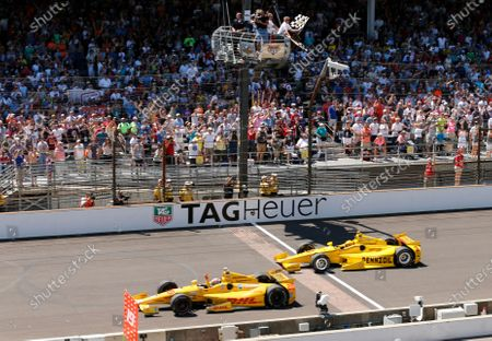 Ryan Hunter-Reay celebrates after crossing the finish line, taking the checkered flag in front of Helio Castroneves, of Brazil, to win the 98th running of the Indianapolis 500 IndyCar auto race at the Indianapolis Motor Speedway in Indianapolis. The Associated Press has updated its survey of living Indianapolis 500 winners and their pick as the greatest race in the long history of the event. There are six races that received multiple votes, topped by Al Unser Jr.'s victory over Scott Goodyear in 1992 - the closest Indy 500 in history. The others are Emerson Fittipaldi's win in 1989; Sam Hornish Junior's win in 2006; the 1982 battle between Rick Mears and Gordon Johncock; the 2011 race won by the late Dan Wheldon; and the 2014 thriller won by Hunter-Reay