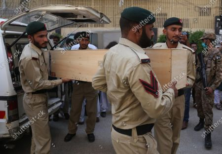 Pakistani Army soldiers carry the coffin containing body of Pakistani Army Major Adnan, a victim of plane crash, during a funeral a day after a passenger plane of state run Pakistan International Airlines, crashed in a residential colony, in Karachi, Pakistan, 23 May 2020. A Pakistan International Airlines passenger flight with over 100 people on board crashed on 22 May as it was preparing to land in the port city of Karachi. According to media reports at least 97 people died in the accident.