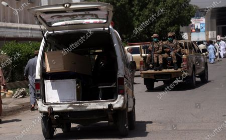 Pakistani Army soldiers escort the coffin containing body of Major Sheharyar, a victim of plane crash, a day after a passenger plane of state run Pakistan International Airlines crashed in a residential colony, in Karachi, Pakistan, 23 May 2020. A Pakistan International Airlines passenger flight with over 100 people on board crashed on 22 May as it was preparing to land in the port city of Karachi. According to media reports at least 97 people died in the accident.