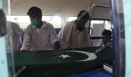 Relatives of Pakistani Army Major Adnan, a victim of plane crash, attend his funeral a day after a passenger plane of state run Pakistan International Airlines, crashed in a residential colony, in Karachi, Pakistan, 23 May 2020. A Pakistan International Airlines passenger flight with over 100 people on board crashed on 22 May as it was preparing to land in the port city of Karachi. According to media reports at least 97 people died in the accident.