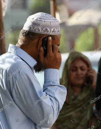 Relatives of victims gather at a mortuary to identify bodies of a Pakistan International Airlines crash the day after it occurred in a residential area, in Karachi, Pakistan, 23 May 2020. A Pakistan International Airlines passenger flight with over 100 people on board crashed on 22 May as it was preparing to land in the port city of Karachi. According to media reports at least 97 people died in the accident.