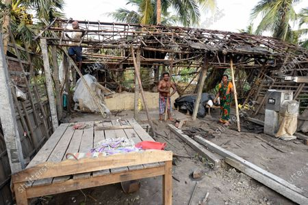 A family rebuilding their home damaged due to Cyclone Amphan, at Kakdwip in the Sunderbans, South 24 Parganas district, on May 22, 2020 in Kakdwip, India.