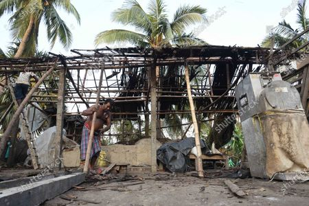 A man rebuilding his home damaged due to Cyclone Amphan, at Kakdwip in the Sunderbans, South 24 Parganas district, on May 22, 2020 in Kakdwip, India.