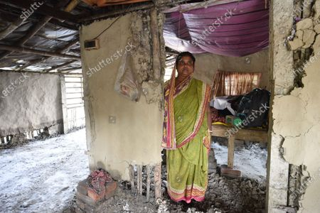 A woman standing in her home damaged due to Cyclone Amphan, at Kakdwip in the Sunderbans, South 24 Parganas district, on May 22, 2020 in Kakdwip, India.