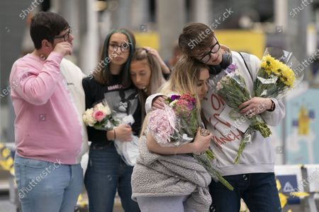 Stock Photo of Peoplpe grieve at a memorial of the Manchester Arena attack in Manchester, Britain, May 22, 2020.   Manchester on Friday marked the third anniversary of the terrorist attack which killed 22 people and injured hundreds. The attack happened when Salman Abedi detonated a bomb at the end of a concert by U.S. pop singer Ariana Grande on May 22, 2017.