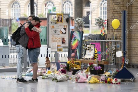 Stock Image of People grieve at a memorial of the Manchester Arena attack in Manchester, Britain, May 22, 2020.   Manchester on Friday marked the third anniversary of the terrorist attack which killed 22 people and injured hundreds. The attack happened when Salman Abedi detonated a bomb at the end of a concert by U.S. pop singer Ariana Grande on May 22, 2017.