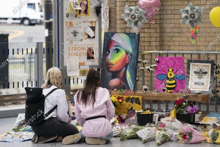 People grieve at a memorial of the Manchester Arena attack in Manchester, Britain, May 22, 2020.   Manchester on Friday marked the third anniversary of the terrorist attack which killed 22 people and injured hundreds. The attack happened when Salman Abedi detonated a bomb at the end of a concert by U.S. pop singer Ariana Grande on May 22, 2017.