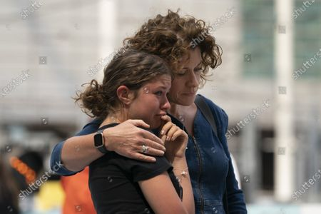 Stock Picture of People grieve at a memorial of the Manchester Arena attack in Manchester, Britain, May 22, 2020.   Manchester on Friday marked the third anniversary of the terrorist attack which killed 22 people and injured hundreds. The attack happened when Salman Abedi detonated a bomb at the end of a concert by U.S. pop singer Ariana Grande on May 22, 2017.