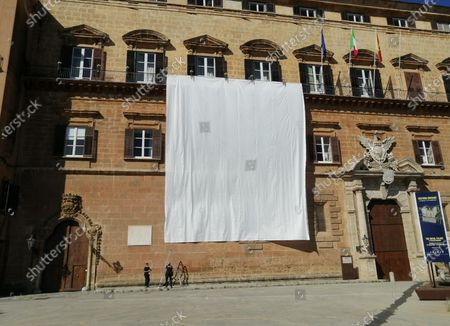 Stock Picture of White sheets on the balconies of the buildings at Palazzo dei Normanni, also called  Palazzo Reale, seat of the Sicilian regional assembly, on the occasion of the 28th anniversary of the Capaci massacre, in Palermo, Italy, 23 May 2020. The Capaci massacre was a bombing orchastrated by the Sicilian Mafia, which killed judge Giovanni Falcone, his wife the judge Francesca Morvillo and three other people from the judge's escort on 23 May 1992.