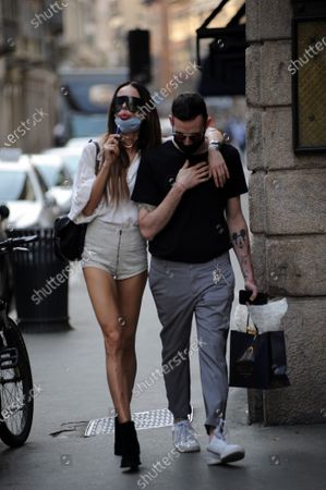 Stock Photo of Nina Moric shopping in the center of Milan with Nicol Grossi, her friend and make up artist to choose perfumes.