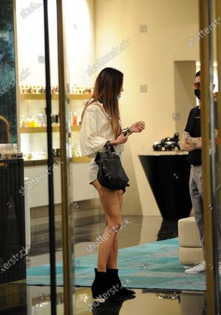 Nina Moric shopping in the center of Milan with Nicol Grossi, her friend and make up artist to choose perfumes.