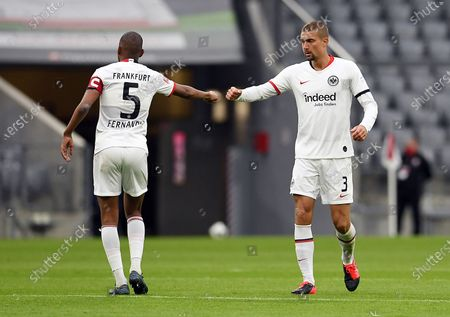 Eintracht Frankfurt's Stefan Ilsanker (R) and Gelson Fernandes celebrate during the German Bundesliga soccer match Bayern Munich vs Eintracht Frankfurt in Munich, Germany, 23 May 2020. The German Bundesliga is the world's first major soccer league to resume after a two-month suspension because of the Coronavirus pandemic.