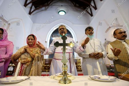 Members of the Christian minority community attend a candle light vigil in remembrance of the victims of the Pakistan International Airlines plane crash, in Karachi during a memorial ceremony in Peshawar, Pakistan, 23 May 2020. A Pakistan International Airlines passenger flight with over 100 people on board crashed on 22 May as it was preping to land in the port city of Karachi. According to media reports at least 97 people died in the accident.