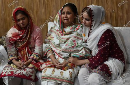Mother (C) of Anam Maqsood, an air hostess victim of a plane crash, mourns along with other family members in Lahore, Pakistan, 23 May 2020. A Pakistan International Airlines passenger flight with over 100 people on board crashed on 22 May as it was preparing to land in the port city of Karachi. According to media reports at least 97 people died in the accident.